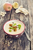 Cream of celery soup with apple and croutons