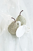 Festive arrangement of glittery pears and gift tag