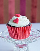 A cupcake with a red sugar heart