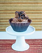 A cupcake topped with chocolate cake