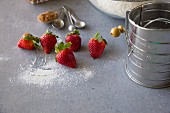 Baking ingredients: strawberries, flour and cinnamon