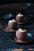 Chocolate bowls filled with cream