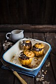 Apples stuffed with dried fruit and almond, baked with cream