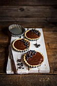 Individual chocolate tarts with blackcurrants