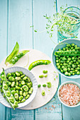 An arrangement of fresh fava beans and peas