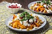 Carrot salad with chickpeas, feta and pomegranate seeds