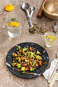 Sprouted mung beans laced with avocado, tomatoes and spices for a healthy salad