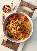 Meatballs and spaghetti with pine nuts and cherry tomatoes