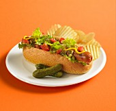 Grilled hot dog in whole wheat bun with relish, mustard, pickles, tomato