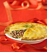 Duck and wild rice pie, with a slice removed