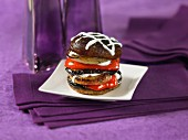 A tower of grilled portobello mushrooms, peppers and onions