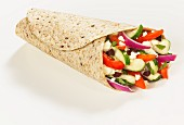Greek salad in a whole grain wrap