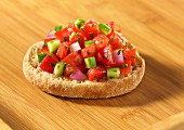 English muffin topped with salsa