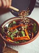 Caramelized carrots with mixed leaves with toasted pine nuts