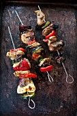 Chicken and lamb skewers with vegetables