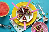 Watermelon slices glazed with chocolate and colourful sugar sprinkles