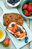 Banana bread with mascarpone, berries and honey