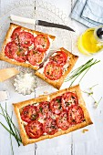 Puff pastry tarts with ricotta, feta and tomatoes (top view)