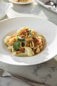 Shell Pasta with Ricotta and Cauliflower in large-rimmed white bowl