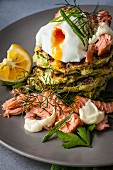 Courgette fritters with smoked salmon and poached eggs (close up)