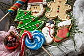 Colourful decorated Christmas biscuits, candy canes and lollipops