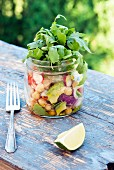 Healthy salad to go in a mason jar