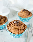 Cupcakes topped with coffee buttercream (close up)