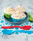 Cupcakes with buttercream and colourful sugar sprinkles