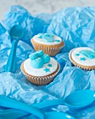 Cupcakes for a baby shower on blue paper