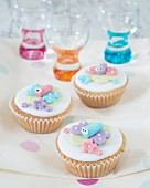 Cupcakes decorated with sugar butterflies and blossoms