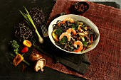 Black noodles with shrimps, chili, mushrooms and vegetables (Asia)