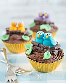 Spring chocolate cupcakes decorated with fondant birds