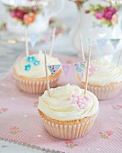 Cupcakes decorated with buttercream, fondant flowers and mini bunting