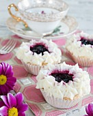 Festive cupcakes topped with jam and cream