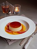 Creme caramel with orange slices