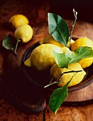 Lemons with leaves in a wooden bowl