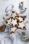 Cinnamon stars in a star shaped gift box