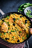 Saffron rice with chicken, peas and fava beans (Spain)