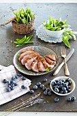 Duck breast with lavender oil, sugar snap peas and blueberries