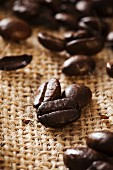 A close-up of coffee beans on a hessian sack