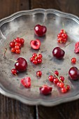 Berries and cherries in a metal bowl