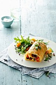 Vegetable strudel with a colorful salad