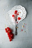 Crushed cranberries on two paper doilies