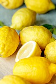 Several whole and halved lemons (close up)