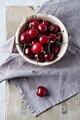Sweet cherries in a wooden bowl