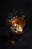 Individual apple, pecan nut and toffee cupcake with sparkler