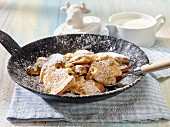 Kaiserschmarren (shredded pancake) with icing sugar