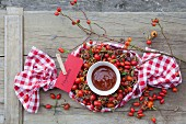 Rose hip jam and fresh rose hips