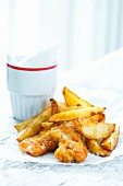 Fried chicken goujons and potato wedges