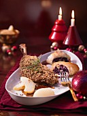 Crumb coated goose with red cabbage strudel and pears (Christmas)
